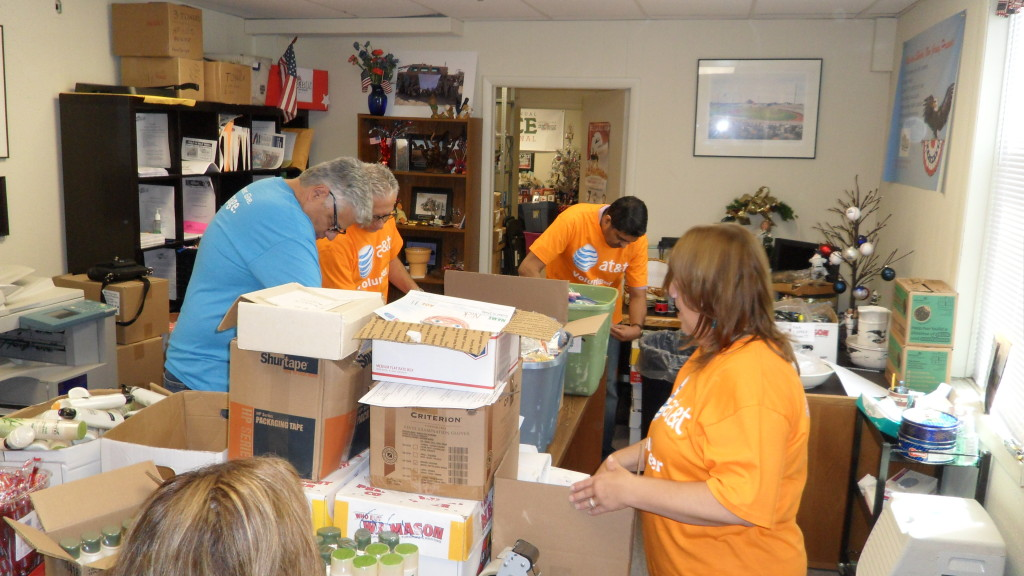 Ten members of the AT&T Pioneers visited Operation Shoebox New Jersey headquarters in Hillsborough Aug. 6 to help assemble care packages and bag loose candy for shipment to US troops overseas. The volunteers packed 100 boxes and 811 bags of candy.